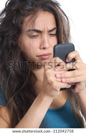 Close up of an upset girl with tousled hair having a bad day on the phone isolated on a white background - stock photo