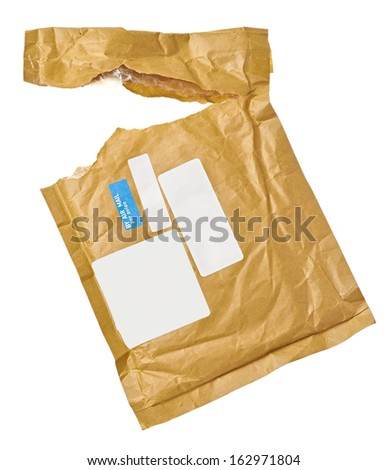close up of an used open mail package on white background with clipping path - stock photo