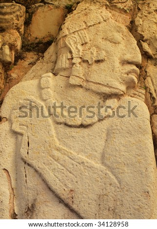 Close up of ancient carving of Mayan prisoner. Ruins of Palenque, Chiapas state, Mexico. - stock photo