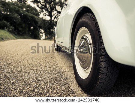 close up of and old vintage car tyre. concept about transportation and vintage - stock photo
