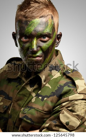 Close Up Of Angry Soldier against a grey background