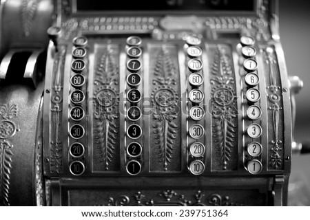 Close up of antique cash-desk, monochrome - stock photo