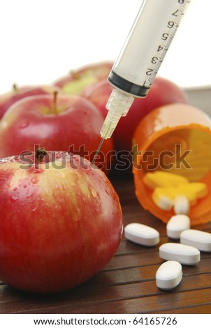 Close up of apples and medical related objects. - stock photo