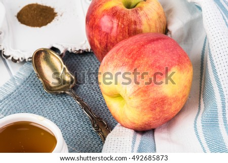 Close up of apples, honey, apple pie spice - ingredients for apple pie in apple.