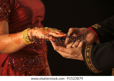 Close up of Arab couple's hands at a wedding, concept of marriage/partnership/commitment - stock photo