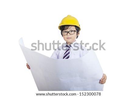 Close-up of architect boy holding blueprint on white background - stock photo