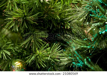 Close-up of artificial fir tree branches sparkling on ends - stock photo