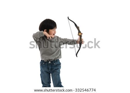 Close up of asian boy holding bow on white background isolated