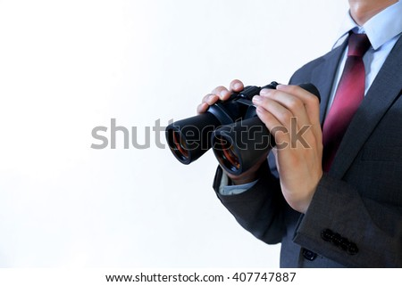 Close-up of Asian Businessman looking for something with binoculars such as business opportunities / jobs / new market - business issues discovery concept - with clipping path