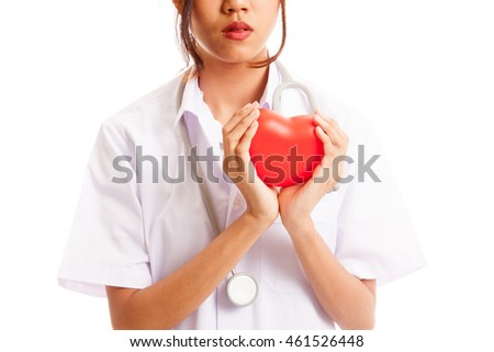 Close up of Asian female doctor hold a red heart and  isolated on white background .