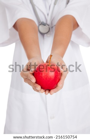 Close up of Asian female doctor show an apple