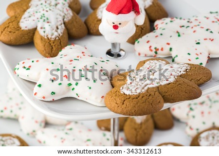 Close up of assorted Christmas cookies on a tiered server tray.