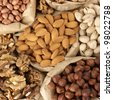 Close-up of assorted nuts in paper bags. Top view point. - stock photo