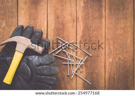 Close up of assorted work tools on wooden background - stock photo