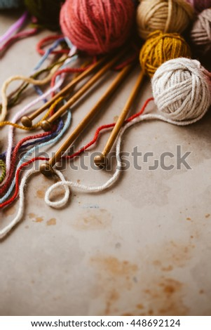 Close up of assorted yarn and wooden needles