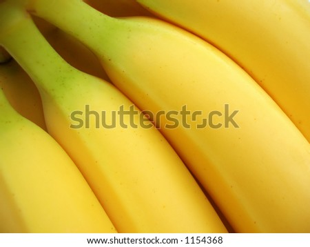 Close-up of at bunch of yellow bananas to be used as a background - stock photo