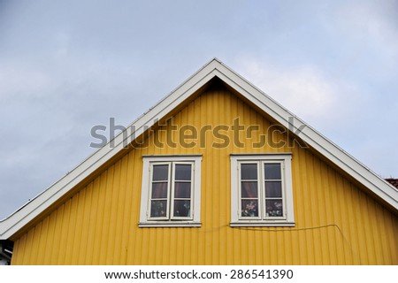 Close-up of attic of wooden scandinavian house - stock photo