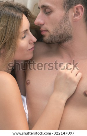 Close-up of attractive couple sleeping after sex