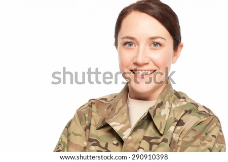 Close up of attractive female Army soldier wearing multicam camouflage on white background. - stock photo