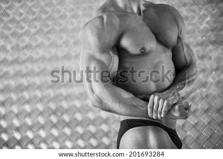 Close-up of attractive male bodybuilder with strong biceps
