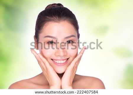 close up of attractive woman face relax smiling with nature green background, asian beauty  - stock photo