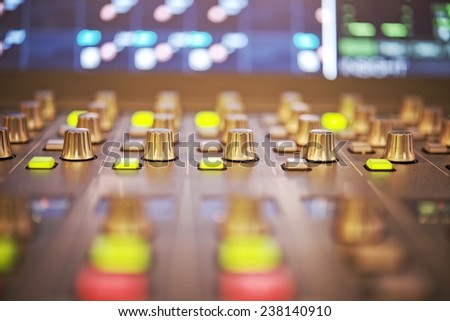 Close-up of audio mixing controller console - stock photo