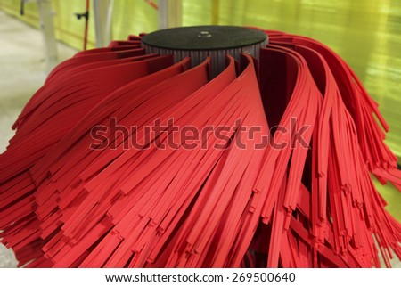Close up of automatic car wash red brushes - stock photo