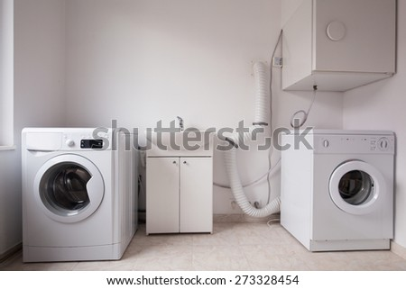 Close-up of automatic washing machines in laundry - stock photo