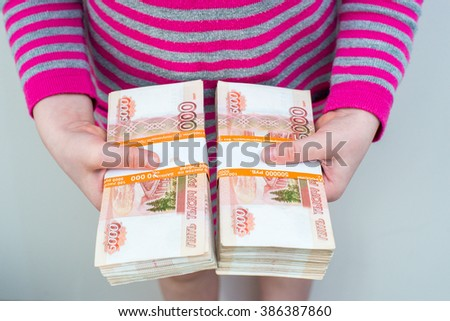 close up of baby hands holding money. Russian rubles