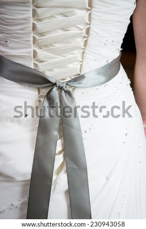 Close up of back of bride's wedding dress - stock photo