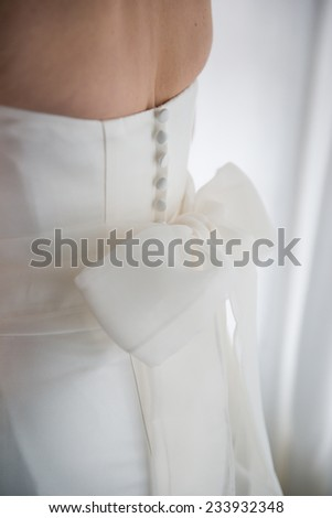 Close up of back of bride's wedding dress detail - stock photo