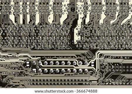Close-up of back side circuit board pattern with pins in rows. Filtered toned image. - stock photo
