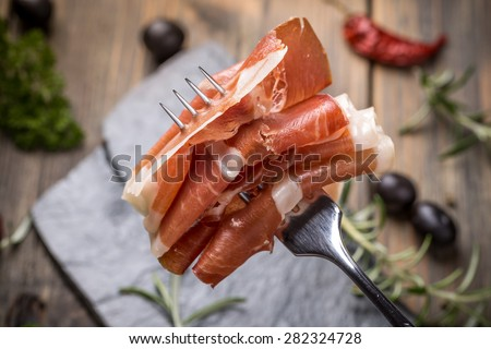 Close up of bacon on a fork - stock photo