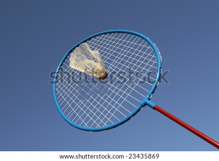 close up of badminton racket and shuttlecock with blue sky background