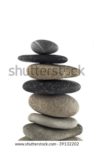 Close-up of Balanced stone stack or tower isolated over white (shallow DOF)