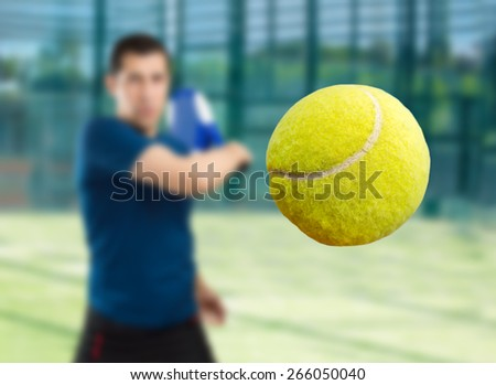 close up of ball of paddle tennis player  - stock photo
