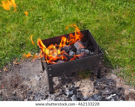 Close up of barbecue grill mangal preparation with fire