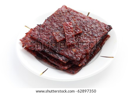 Close up of barbecue meat stacked on white plate isolated over white background. - stock photo