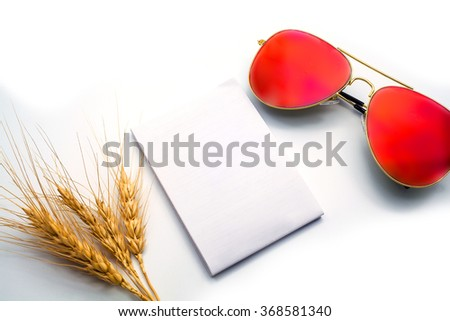 close up of  barley , notebook ,and glasses in composition in black and white - stock photo