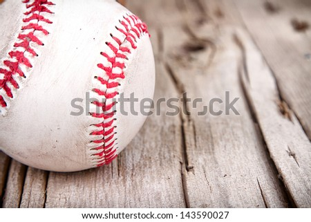 Close-up of baseball on rustic wooden background