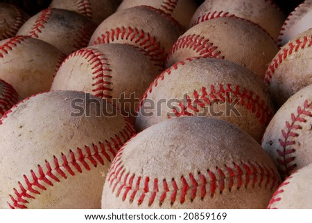 Close-up of baseballs with stitches highlighted well.