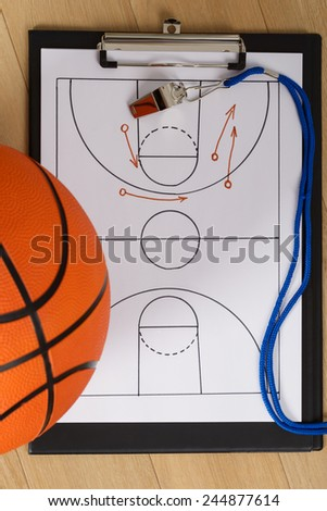 Close-up Of Basketball With Whistle And Sport Tactics On Paper - stock photo