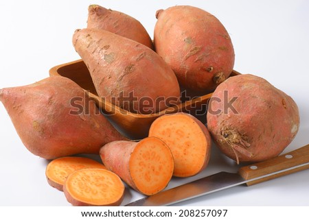 close up of batata sweet potatoes and kitchen knife