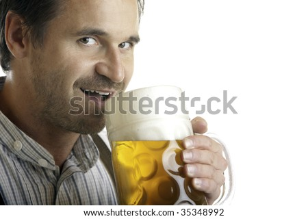 Close-up of Bavarian man which drinks out of Oktoberfest beer stein