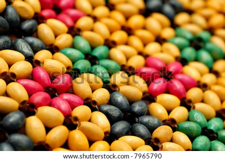 Close-up of beads on a Mexican style handbag - stock photo