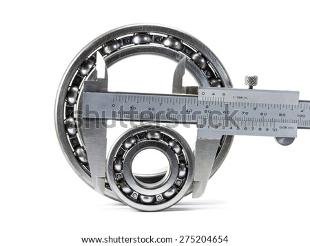 Close up of bearings and vernier caliper isolated on white - stock photo