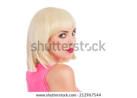 Close up of beautiful blond young woman looking over her shoulder. Head and shoulders studio shot isolated on white. - stock photo
