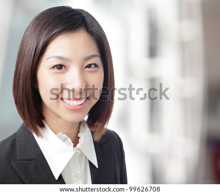 Close up of beautiful business woman smile face with office background, model is a asian beauty - stock photo