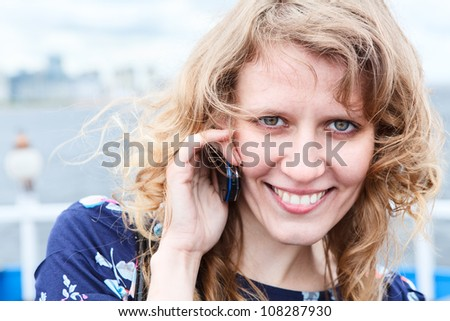 Close up of beautiful Caucasian woman with mobile phone. Copyspace - stock photo