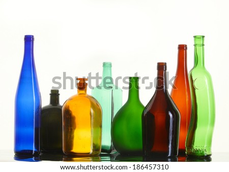 close-up of beautiful colorful empty bottles without caps isolated on white background studio